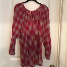 Free people top New with tags shorter in the front longer in back with a short slit in back Free People Tops Blouses