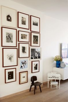 Floor to ceiling, brown frames, black and white photos