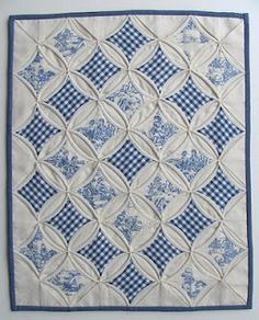 Gingham cathedral window quilt.