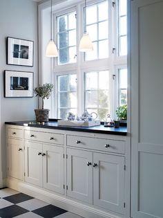 White kitchen black and white tiled floor.... soft gray walls
