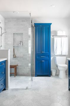 A bold, blue cabinet makes for a striking vista into this remodeled master bathroom. Carla Aston, Designer | Tori Aston, Photographer Master Bath Remodel, Diy Bathroom Remodel, Bathroom Makeovers, Budget Bathroom, Bathroom Ideas, Bathroom Inspo, Shower Ideas, Diy Vanity, Design Seeds