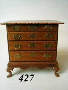 George Passwaters, IGMA fellow - 4 drawer chest with snake feet; mad in 1987; sold at auction for $650