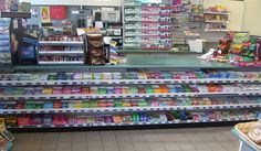 Use our gondola check out slanted shelves to display your merchandise at an angle. Market Displays, Merchandising Displays, Store Displays, Shop Shelving, Display Shelves, Grocery Items, Grocery Store, Convinience Store, Gondola Shelving