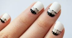 Black, white and gray from the moon with the accent of silver striping tape free hand nail art