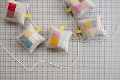 [Karen Barbé | Textile designer | Embroidered pincushions]