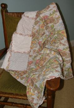This beautiful handmade one of a kind baby rag quilt is a beautiful depiction of numerous Mother Goose nursery rhymes. So many of our favorites