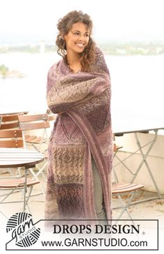 "Knitted DROPS blanket in ""Delight"" and ""Alpaca"" with squares in different textured patterns. ~ DROPS Design"