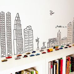 House & Home : Book storage for Children's rooms, love the black and white wall decor