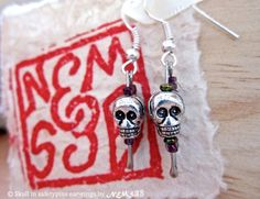 skull in safetypin ear-rings by NemSeb