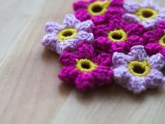 The pattern for the fabric made of crochet blossoms, is…
