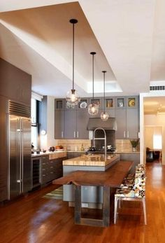 Modern-kitchen-design-pndant-light-and-cutting-edge-table.Unique kitchen countertop featuring a wooden slab table incorporated into a kitchen island to create space saving design. Sweet Home, Cocinas Kitchen, Cuisines Design, Modern Kitchen Design, Modern Design, Style At Home, Beautiful Kitchens, Contemporary Interior, Kitchen Contemporary