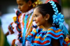 folklórico ballet dancer, southern California cultural celebration by Manuel Gamboa. The bright blue ribbon woven into her dark brown hair is gorgeous. Ballet Hairstyles, Hispanic Heritage Month, Photo Exhibit, Hispanic Culture, We Are The World, World Photography, Festival Dress, My Heritage, Kids Events