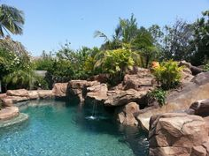 Beautiful backyard  with tropical lagoon pool & waterfall. Love!!