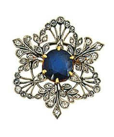 a Belle Epoque platinum brooch, set to the centre with a circular-cut sapphire within a pierced foliate mount set with single and rose-cut diamonds, circa 1910