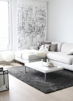 grey + white living room. Looks so warm. I want to have a fur on my sofa, too