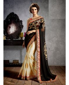 Black and cream half and half sari with golden border   1. Black and cream georgette jacquard net sari2. Floral embroidered pallu3. Comes with matching unstitched blouse