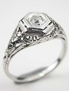 1920s engagement ring. Love it. Goes along with Titanic themed wedding music <3