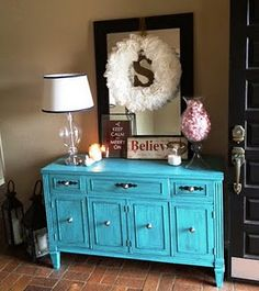 entry way--pop of color amongst the neutrals and dark tones... But I'd do red instead of blue