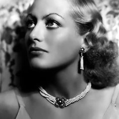 Scandal continued to follow Joan Crawford throughout her highly successful career. There were stories about the star's legendary relationship with Clark Gable, her countless love affairs, her marriages - three of them to gay men - and her obsession with, and voracious appetite for, rough sex.Even at the peak of her career rumours continued to surface about how her loathed mother forced Crawford to work as a prostitute, make blue movies and sleep her way to the top.