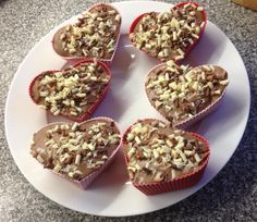 Chocolate heart cakes for Valentine's Day, iced with melted Dairy Milk chocolate and covered with chocolate curls. Delicious with custard as the warm custard melts the chocolate.