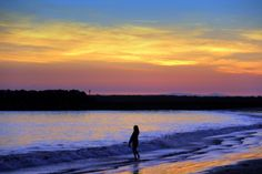 Playing in the jeweled colors of night, Corona Beach Newport.