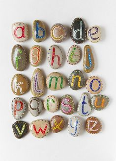 Alphabet Pebbles:  What a marvelous little rainy day project! What a great shower gift for baby tied up in a little baskets or made into magnets.  Great as teacher gifts, Trim out a cute mirror or bulletine board for a child's room....endless ideas! Puzzle glue will shine them up and protect from chipping.