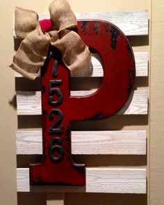 Monogram and street address metal numbers (both on sale) from Hobby Lobby, repurposed pallet wood (free) with a little white spray paint, some burlap and some screws. Easy deco for the front porch!
