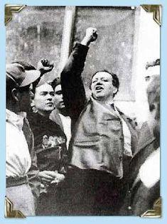 Frida, Diego, fists, anti-fascist demonstration, Mexico City 1954 Photo credit: AP/Worldwide