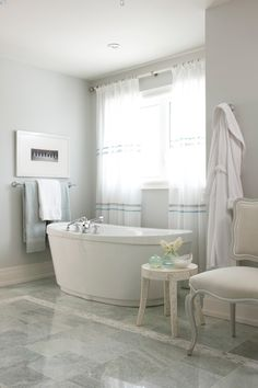 A closer look at the bathroom with its deep soaking tub, seating, & even a place to hang your bathrobe. Ahhhh.......V