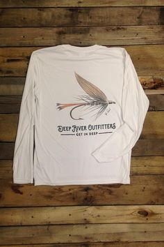 Deep River Outfitters celebrates the sport and art of fly fishing with our Wasp Fly Long Sleeve Solar Performance tees, perfect for the river or every day featuring up to 50 UPF solar protection and moisture wicking technologies. Original art by Tyler Daniel is printed on our White 100% microfiber polyester long sleeve solar performance tee.