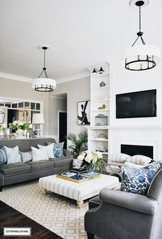 Grays and lighy blue cushions o dark couch