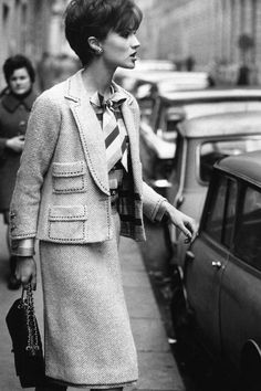 Chanel 1960   Model wearing Chanel suit and bag, 1960 (plus, I love her haircut!)