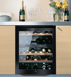 """Looking for a modern black with glass dual zone 24"""" undercounter wine refrigerator. Check out the Miele KWT4154UG1. Holds up to 38 bottles. Love the black door!"""