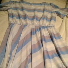 Vintage blouson dress from 1960's size 16. Adorable vintage blouson top, Aline dress with square neckline and 3 buttons on shoulders in amazing vintage condition, from 1960's. Bias Stripes of light blue, gray and white. Size 16 would work fine for a 14 or 18 based on measurements and stretch! Vintage Dresses
