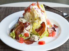 Try Glenmorgan's Iceberg Wedge #Salad with chopped tomato, sliced red onion, warm bacon, and crumbled blue cheese dressing from their Valentine's Day Dinner menu.