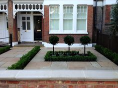 Imperial red brick London wall stone pier caps sandstone paving and formal topiary classic front garden Balham Victorian Front Garden, Victorian Gardens, Victorian Terrace, Garden Design London, London Garden, Small Front Gardens, Small Front Garden Ideas Terraced House, Garden Paving, Gardens