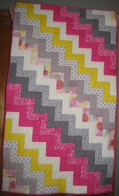 Also a good tutorial for a chevron quilt - I think I could quilt this myself?