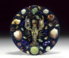 A FRENCH TROMPE L'OEIL PALISSY WARE DISH  Circa 1870-80, impressed T.S. monogram for Thomas-Victor Sergent  Moulded and applied with a central lobster, surrounded by conch, snail, mussel, cockles, whelks and other seashells including an urchin, on a rustic ground circular plate, the reverse pierced for hanging  11¼ in. (28.5 cm.) diameter
