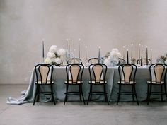 We are on Cloud 9 after glimpsing these modern ethereal wedding ideas with sculptural flower and cake inspiration non-stop! Featuring an icy blue meets matte noir palette, this couple celebrates their love of high fashion, unexpected flower combinations and contemporary furniture in an industrial warehouse setting, and we. are. obsessed.