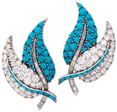 A Pair of Turquoise Diamond Ear Clips, circa 1950's. Each designed as two overlapping leaves, one leaf pavé-set with diamonds, the stem set with calibré-cut turquoise, the other leaf pavé-set with turquoise cabochons, the stem set with baguette-cut diamonds, circa 1950s, French assay marks for 18ct gold and platinum. Via 1stdibs.