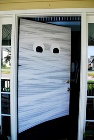 All you need is white streamers and construction paper to make this adorable mummy door!