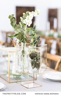 Square gold terrarium with white and green florals | Photo by Marsel Roothman