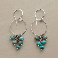 "Blue turquoise beads swing and sway on sterling silver hoops. Handmade in the USA. Exclusive. Color and matrix of stones will vary. 1-1/2""L."