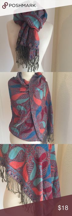 Pashmina Paisley Shawl Warm and stylish with a bright contemporary take on paisley. Knotted fringe hem. Snuggle it around your neck or drape it over your shoulders. Measures 26 x 64 inches. Accessories Scarves & Wraps