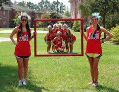 Love this! New member Ed and VPM holding the frame with the new pledge class inside! Soo cute!