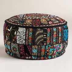 Pouff ottoman Made of vibrant recycled fabrics with embellishments and Indian patchwork, our exclusive pouf is a brilliant extra seating solution. This portable pouf adds color and comfort to any room.