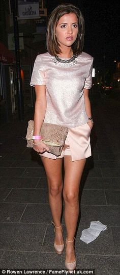 Pretty in pink: Lucy opted for a metallic top with satin shorts and nude heels