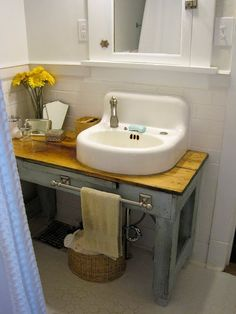 I'm trying to figure out how I keep my vintage bathroom look while gaining counter space.  This is a great answer.