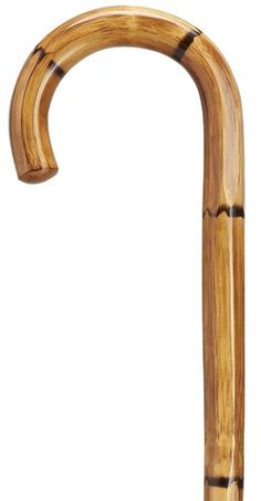Hexagon Manilla Carving Cane Men's crook handle, genuine hexagon shaft of manilla with full length vertical carving. The shaft is 36 inches long and tapers from 7/8 inch to 3/4 inch in diameter. Repla