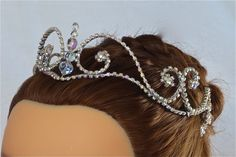 This stunning silver and Aurora Borealis headpiece is ready to ship! This simple and elegant design can be worn either forward, close to the